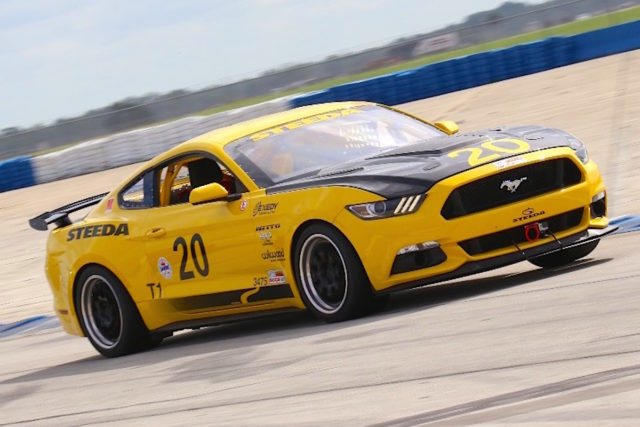 """Steeda was on hand with a full array of its project car, including its latest 20 Car, a yellow S550 racer. """"Racing either proves a theory or it destroys it. We are out here hardcore testing getting ready for our next race event. We went one direction this weekend and we found that we need to back off and go in another direction. Without being here, we wouldn't be able to know that,"""" Dario Orlando said this car's testing."""